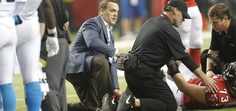 Dr. Spero Karas, one of America's top sports medicine specialists on the field with injured Atlanta Falcons player